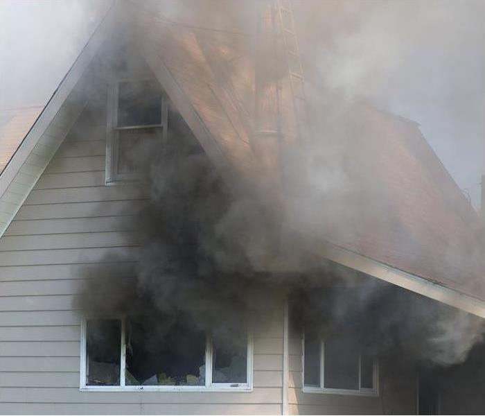 Smoke from a fire inside of a house